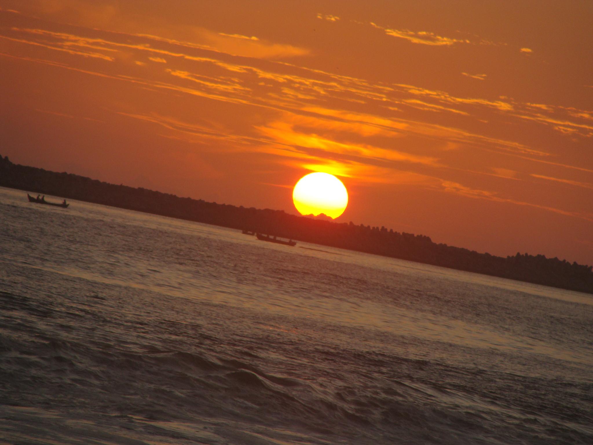 sunset at kollam beach